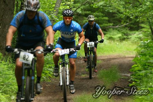 Three Mountain Bike Racers